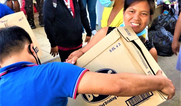 SM distributes boxes of water relief to Taal eruption victims  in Batangas, Lipa