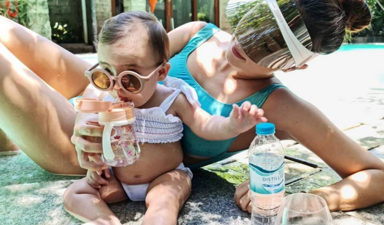 First Time Parents Nico Bolzico and Solenn Heusaff are teaching Tili to love water